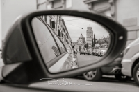 The Leaning Tower Of Pisa, Italy, viewed in a car wing mirror